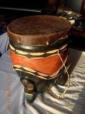 African drum carved painted with string to carry. Skin possibly goat