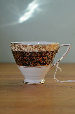Vintage Royal Stafford black and gold tea cup 3195 No 324