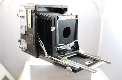 Speed Graphic, 5x4,  early focal plane shutter camera with lens board.