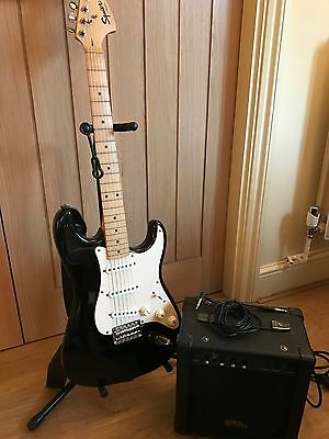Fender Stratocaster in ebony with amplifier and stand