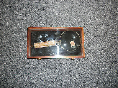 Large magnifying glass in wooden box