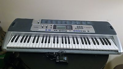 CASIO Lighting System Midi Keyboard LK-110 Battery Operated comes with AC Adapt