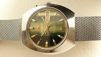 Vintage Orient automatic watch with green dial and faceted crystal