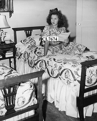 Shirley Temple Reading Some of Her Fan Mail on the Bed Photo