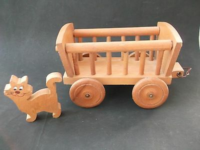 Vintage wooden toy hay cart with a wooden cat