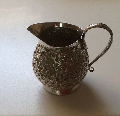 vintage Indian silver cream jug foliage relief
