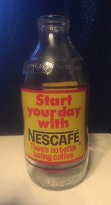 Vintage Unigate advertising 1 pint milk bottle 'Start your day with Nescafe'