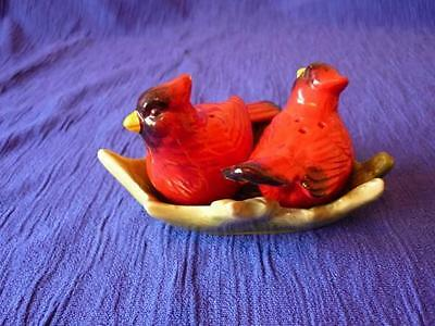 Pottery Salt and Pepper, Depicting a pair of Cardinals (Birds) on a holly leaf.