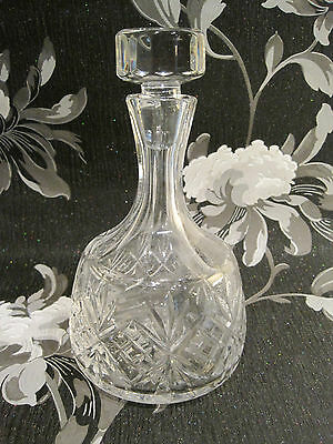 A beautiful cut crystal glass decanter with solid glass stopper