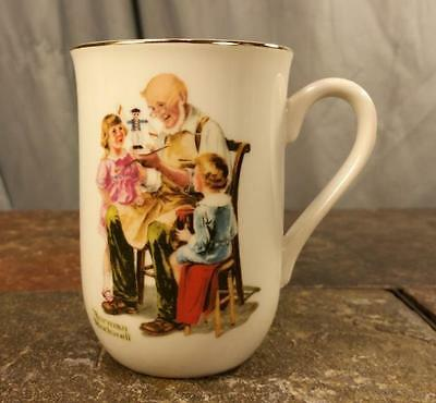 "Norman Rockwell ""The Toymaker"" 1982 Porcelain With Gold Trim Coffee Mug Tea Cup"