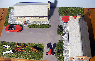 """Two bungalows with gardens and road,""""00"""" model railway building, diorama."""