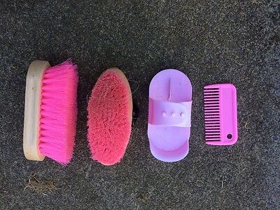 pink grooming brushes