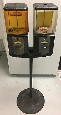 A Double Head Gumball Machine With Stand