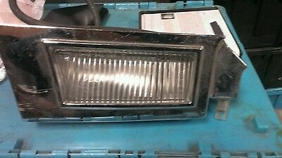 Nos 1965 Oldsmobile 88/98 right cornering lamp assembly with bezel  916506