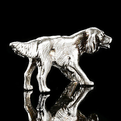 "Figurine miniature:  ""Dog hunting"". Solid silver."