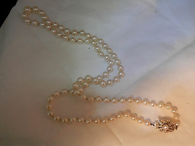Vintage natural pearl graduated single strand necklace with knots 9K gold