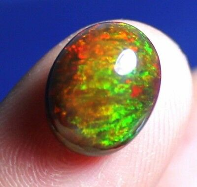Natural Grade Gemstone Black Ethiopian Fire Opal Oval Shape Cabochon  2.4 ct