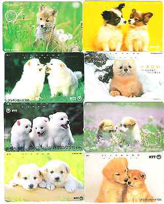 Dogs selction of 8 phonecards from Japan used.