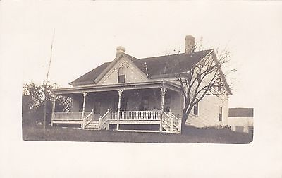 Real Photo CYKO 1904-1920's Publisher. Black & White. House, People on Porch.