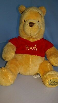"""Disney Store Exclusive Winnie The Pooh approx 9"""" high when sitting"""