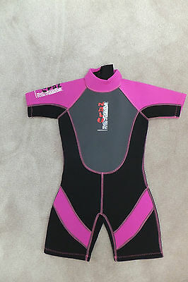 "A  girls shortie wetsuit, wet suit  beach age approx 5-7 chest 24"" ex condition"