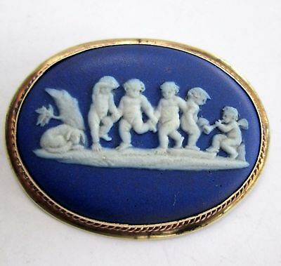 Large antique Victorian gold metal mounted Wedgwood cherub cameo brooch