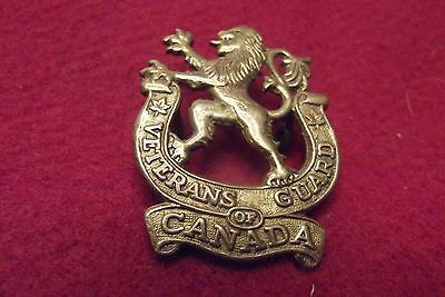 WW II Canadian Brass Cap Badge To The Veterans Guard Of Canada
