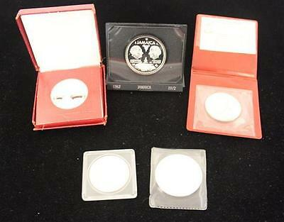 †4 FOREIGN SILVER PROOF COINS INCLUDING GUINEA, JAMAICA, AND BAHAMAS ... Lot 625