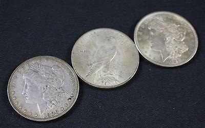 †3 U.S. SILVER DOLLARS INCLUDING 1880, 1921 MORGANS AND 1923 PEACE *... Lot 1870