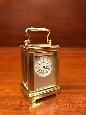 A Miniature Brass Carriage Clock. Open To Offers