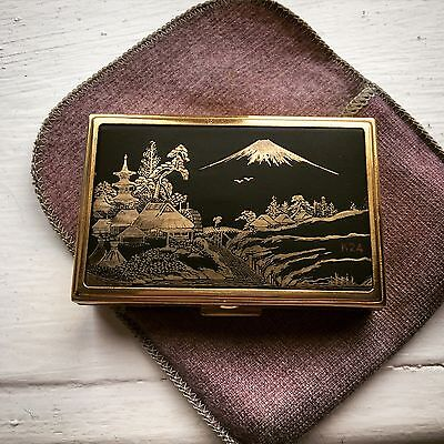 An antique Japanese inlaid gold music box (working)