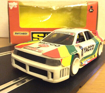 SCX 83630.20 Audi 90 Yacco Wide Body 4WD Slot Car with lights runs on Scalextric