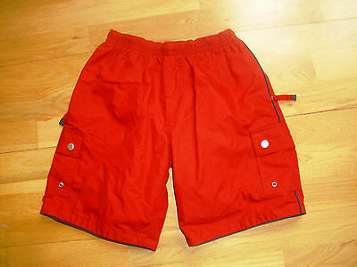 Boys red shorts age 10 zipped pockets excellent condition
