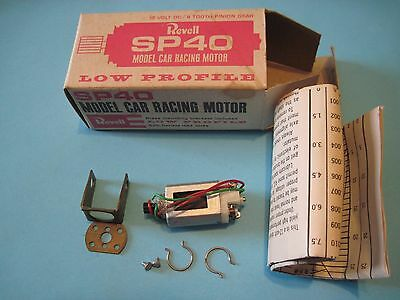 1/32 slot car Revell SP40 motor with parts , box and information . Low profile