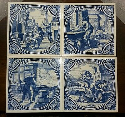 4 lovely handmade delft tiles excellent condition!