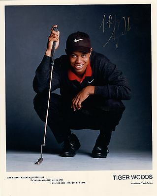 TIGER WOODS autographed vintage 8x10 photo          AWESOME POSE WITH GOLF CLUB