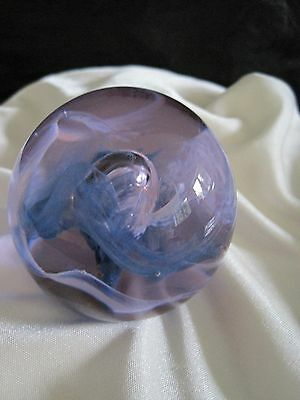 A beautiful round  paperweight pinks purples