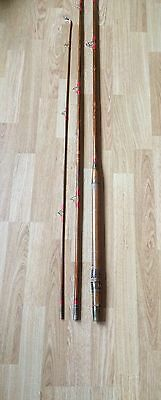Vintage Bamboo fishing rod with canvas rod bag.