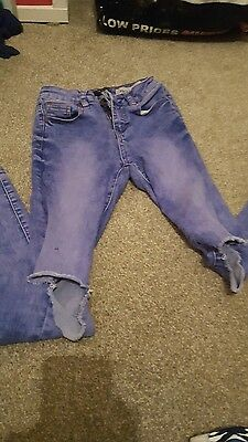 New look,  blue knee ripped jeans.
