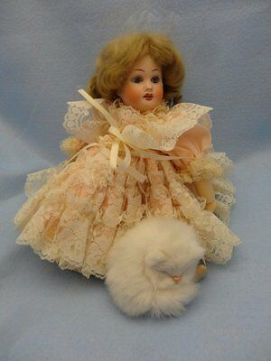 "11"" French Reproduction doll with elaborate outfit, mohair wig, Mint"