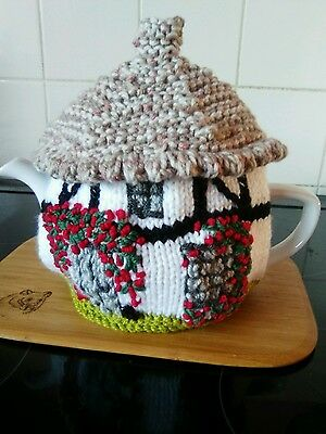 Handknitted black and white rose tree cottage tea cosy