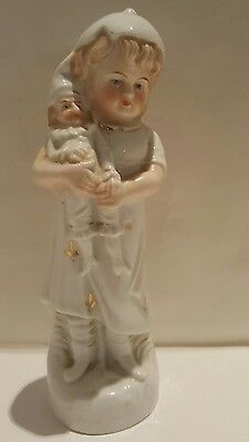 Late Victorian Porcelain Figurine Of A Girl Holding A Punch Doll