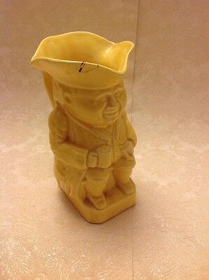 """Seated Man In Coat And Hat Holding Jug. Yellow Colour Toby Jug 7.75"""" Tall"""
