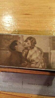 A reproduction snuff box with couple kissing