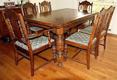 Antique English oak dining room table and 6 chairs