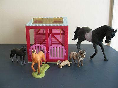Lot of 4 toy plastic horses , stable and dog