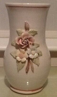 Pottery Vase with flower decor.