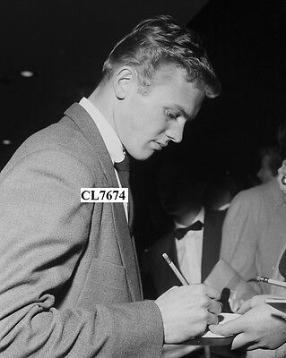 Tab Hunter Signs His Autographs at a Movie Premiere in Los Angeles Photo
