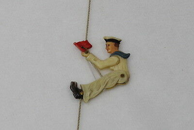 Vintage miniature penny toys, sailor climbing on a rope. functional