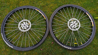 """Mavic wheels with XTR hubs, center lock discs included, 26"""", with road tyres"""